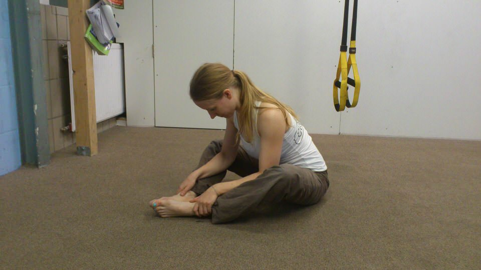 prevent a stiff back after climbing back stretch